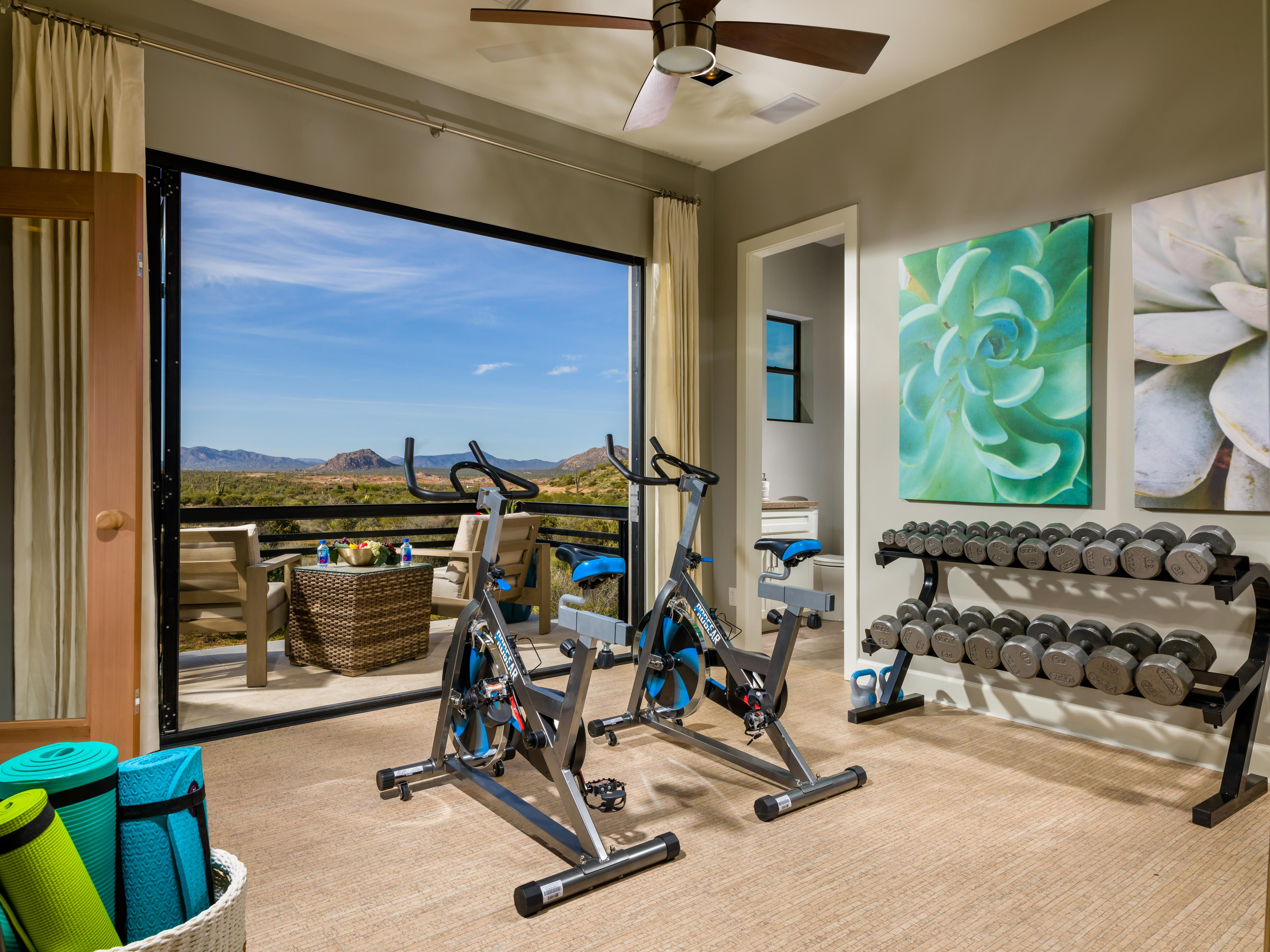 Home gym with a view of mountains.