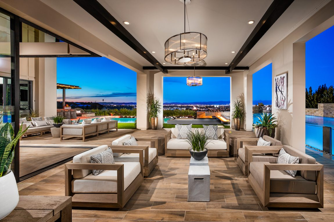 Indoor to outdoor living area with city view.
