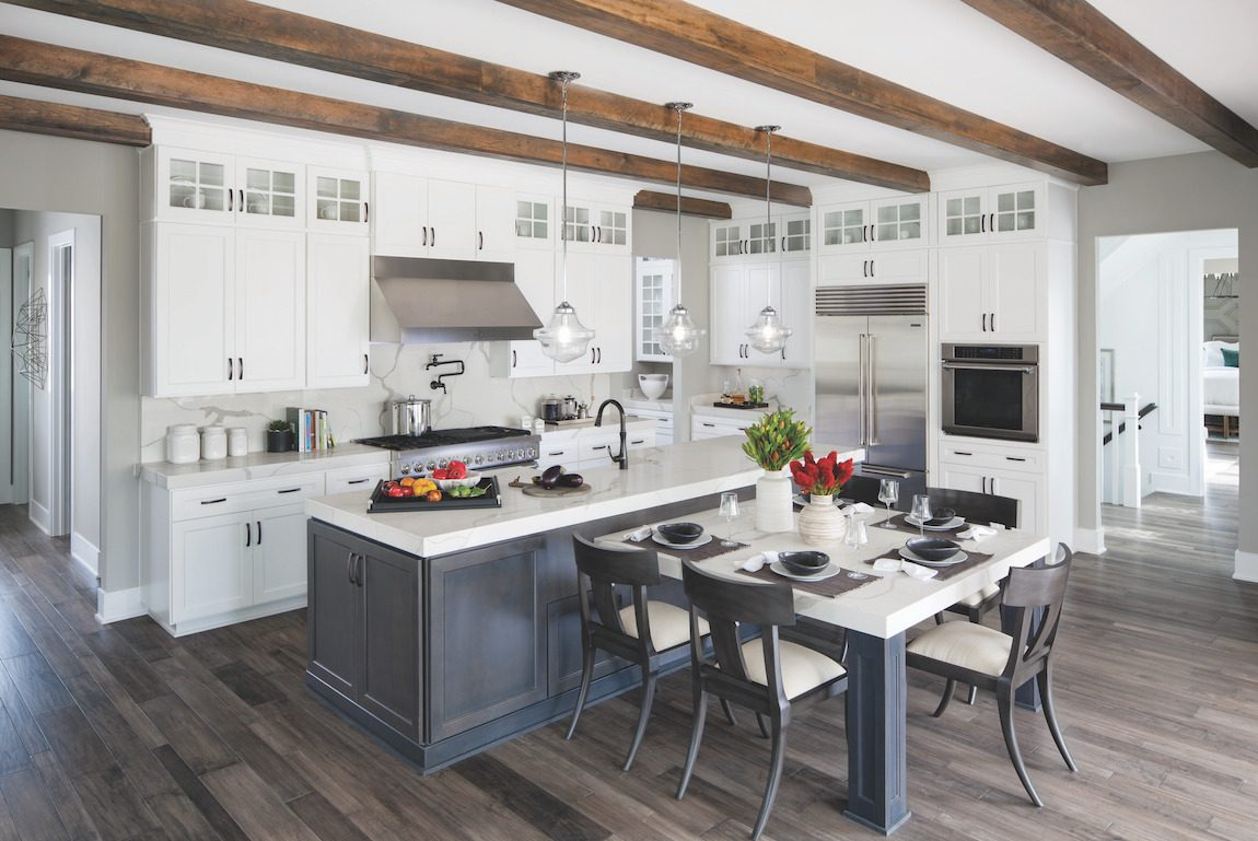 Kitchen with wooden beams and gray island.