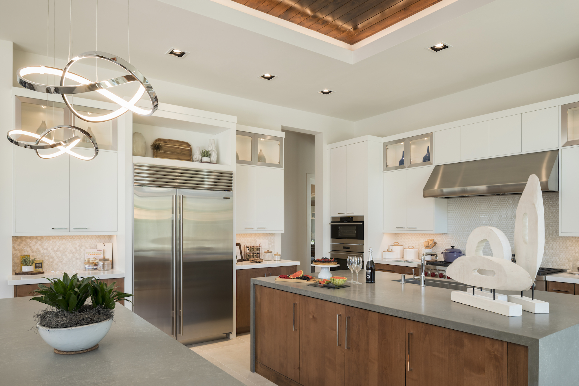 Toll Brothers kitchen with white cabinets and stainless steel appliances
