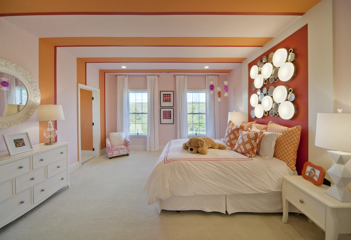 A child's room with orange color accents.
