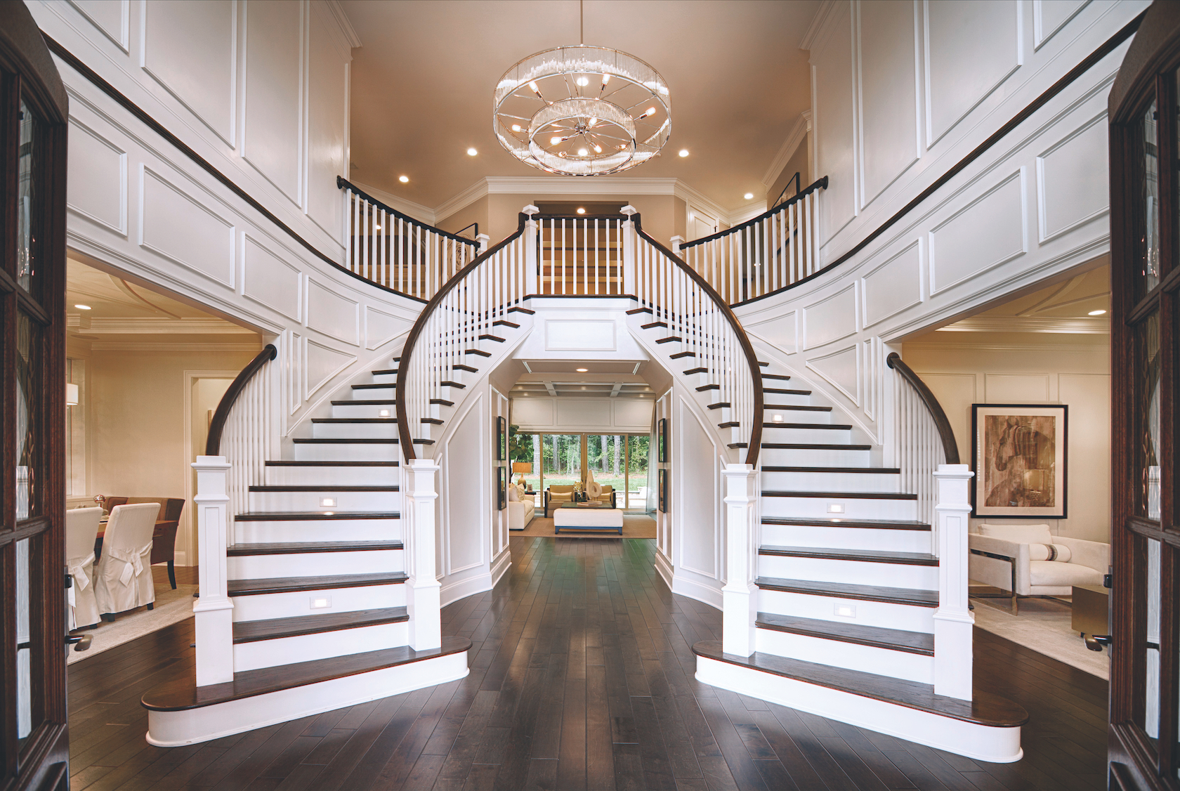 Dual staircase in the entryway of a house.