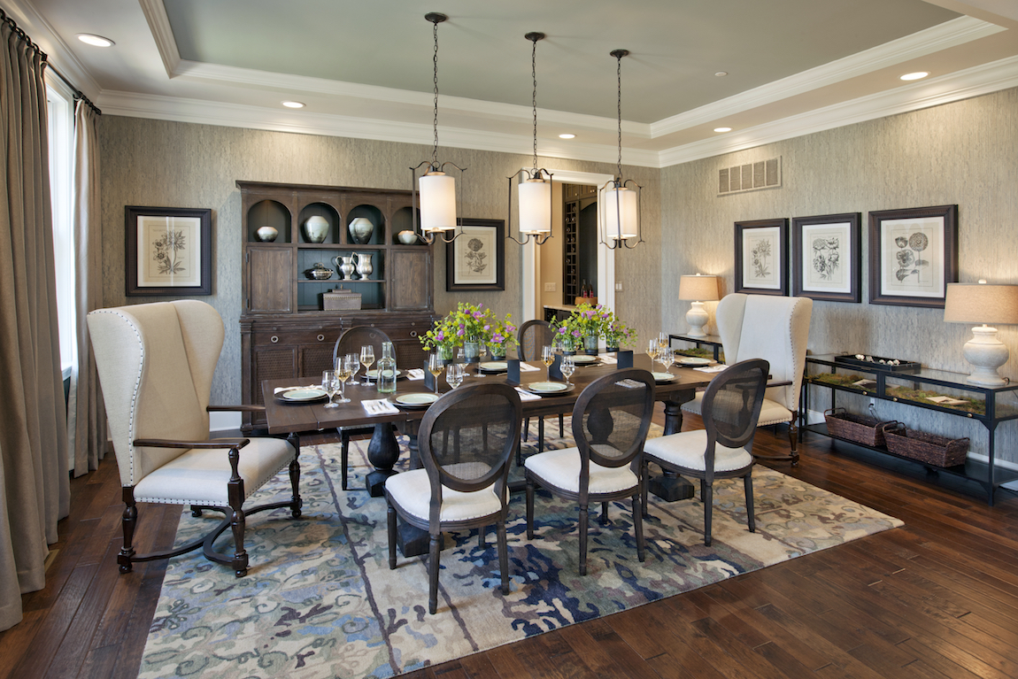 A dining room with pendant lighting.