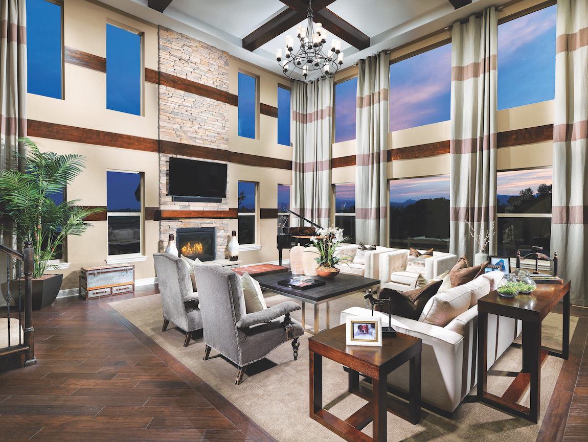 A great room with large windows and a high ceiling.
