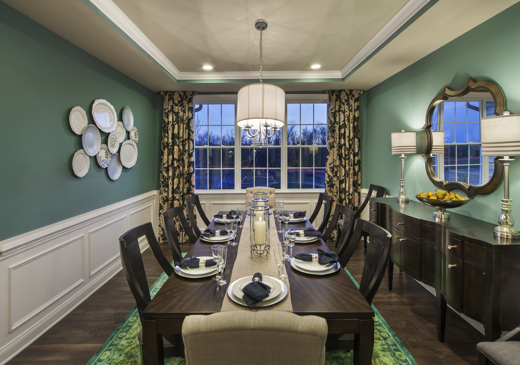Dining room with green color walls.