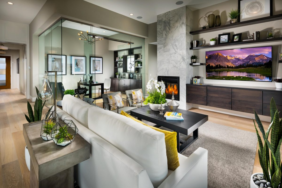 A luxurious living room with a potted plant on a coffee table.