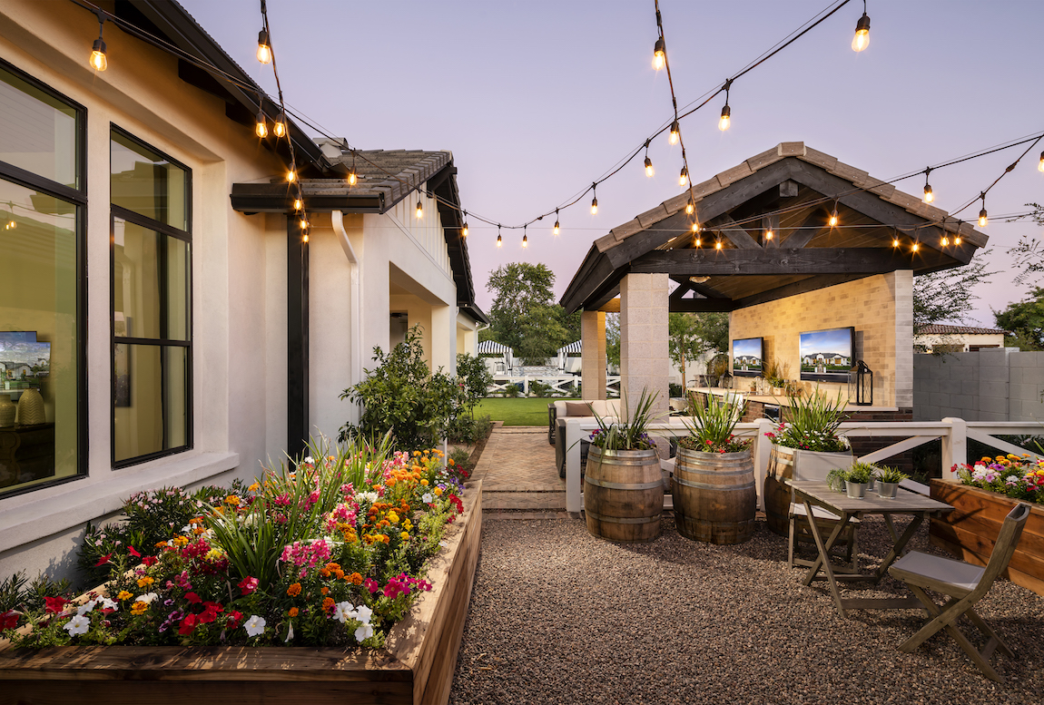 Backyard patio with outdoor string lights.