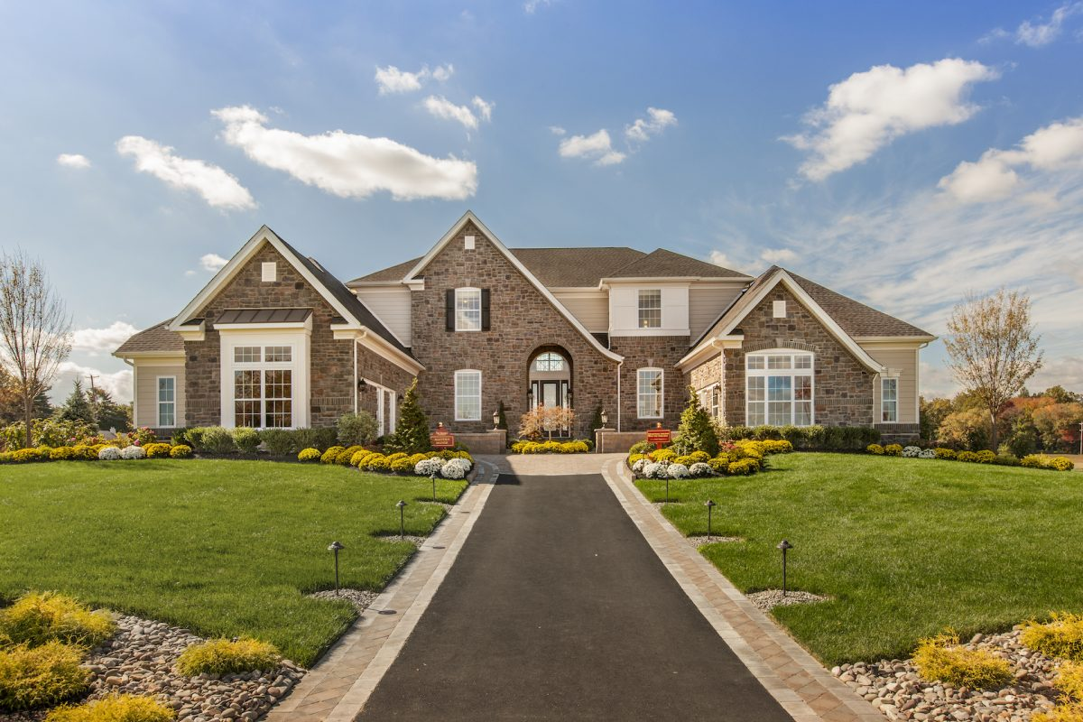 A big house with a freshly cut lawn and curb appeal.