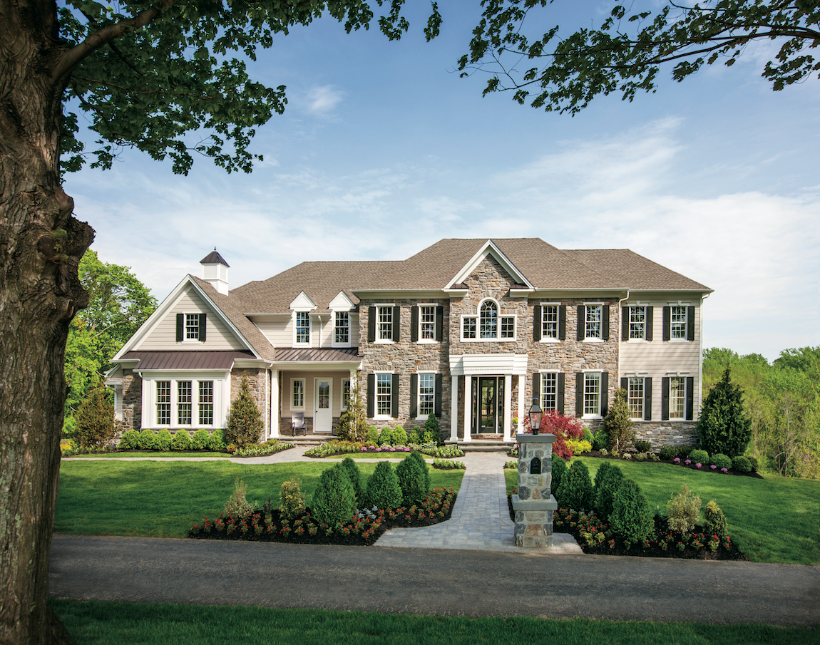 A suburban house in Pennsylvania with hardscaping and curb appeal.