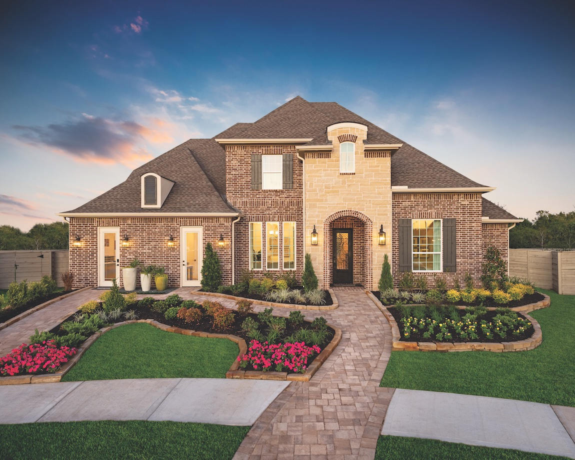 Home in Texas with brick exterior and landscaping.
