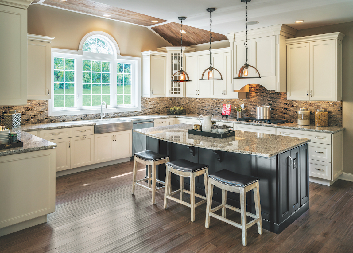 A Toll Brothers kitchen with unique kitchen lighting.