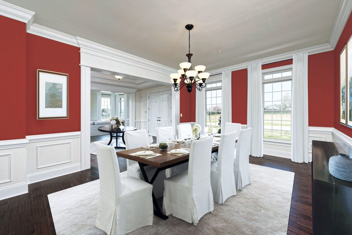 Dining room with rave red color paint.