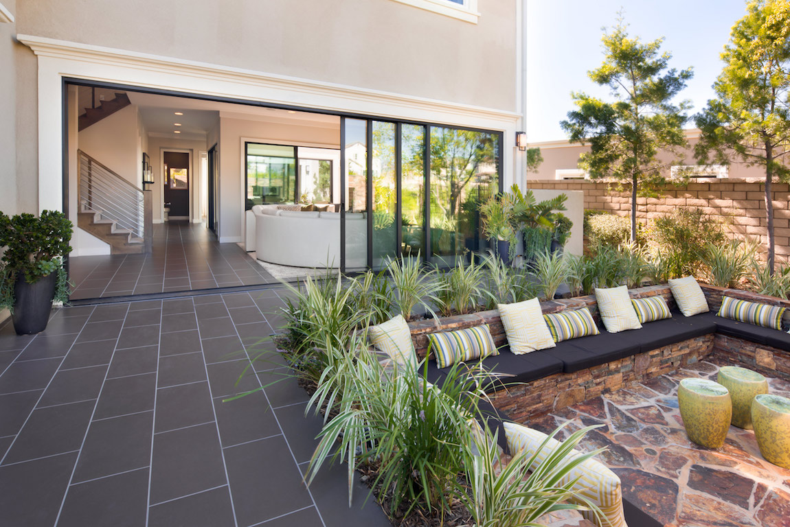A luxury home in Arizona with a sliding door open to an outdoor space.