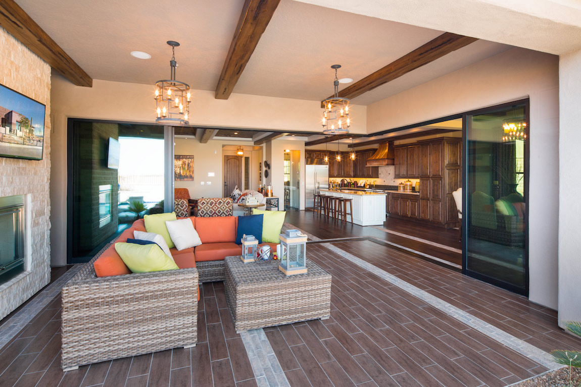Living room with natural light from the outside and wood beams in the ceiling.