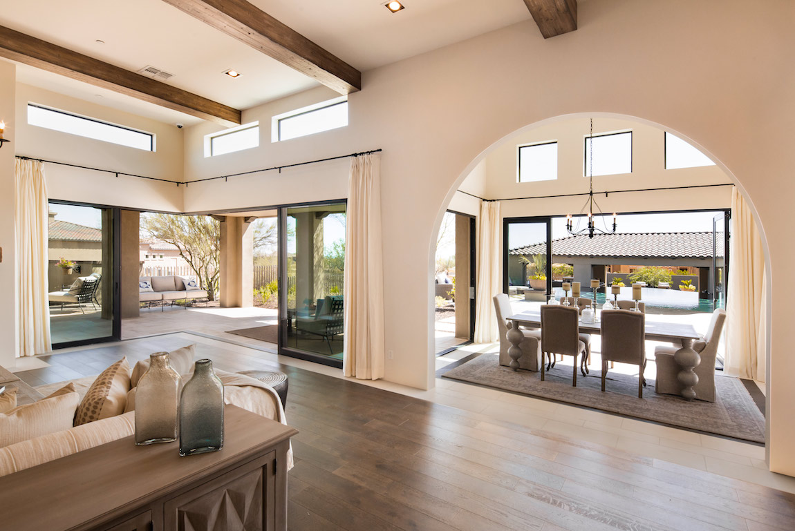 A luxury home in Arizona with floor to ceiling glass sliding doors and lots of natural light.