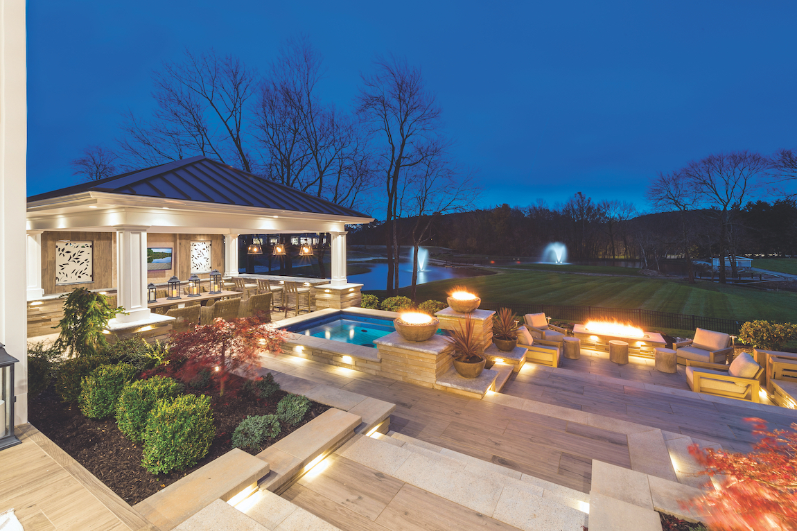 Luxurious outdoor space with a fire pit in a New Jersey home.