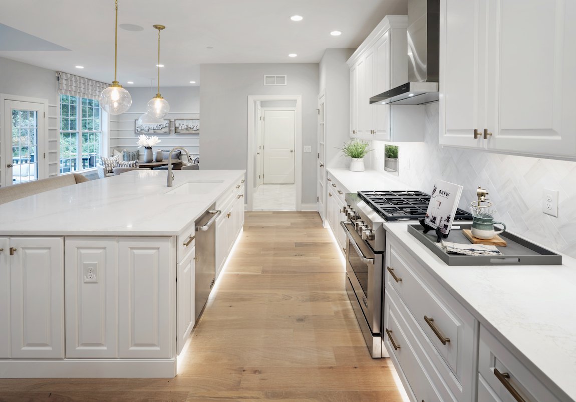 A modern kitchen with floor lighting.