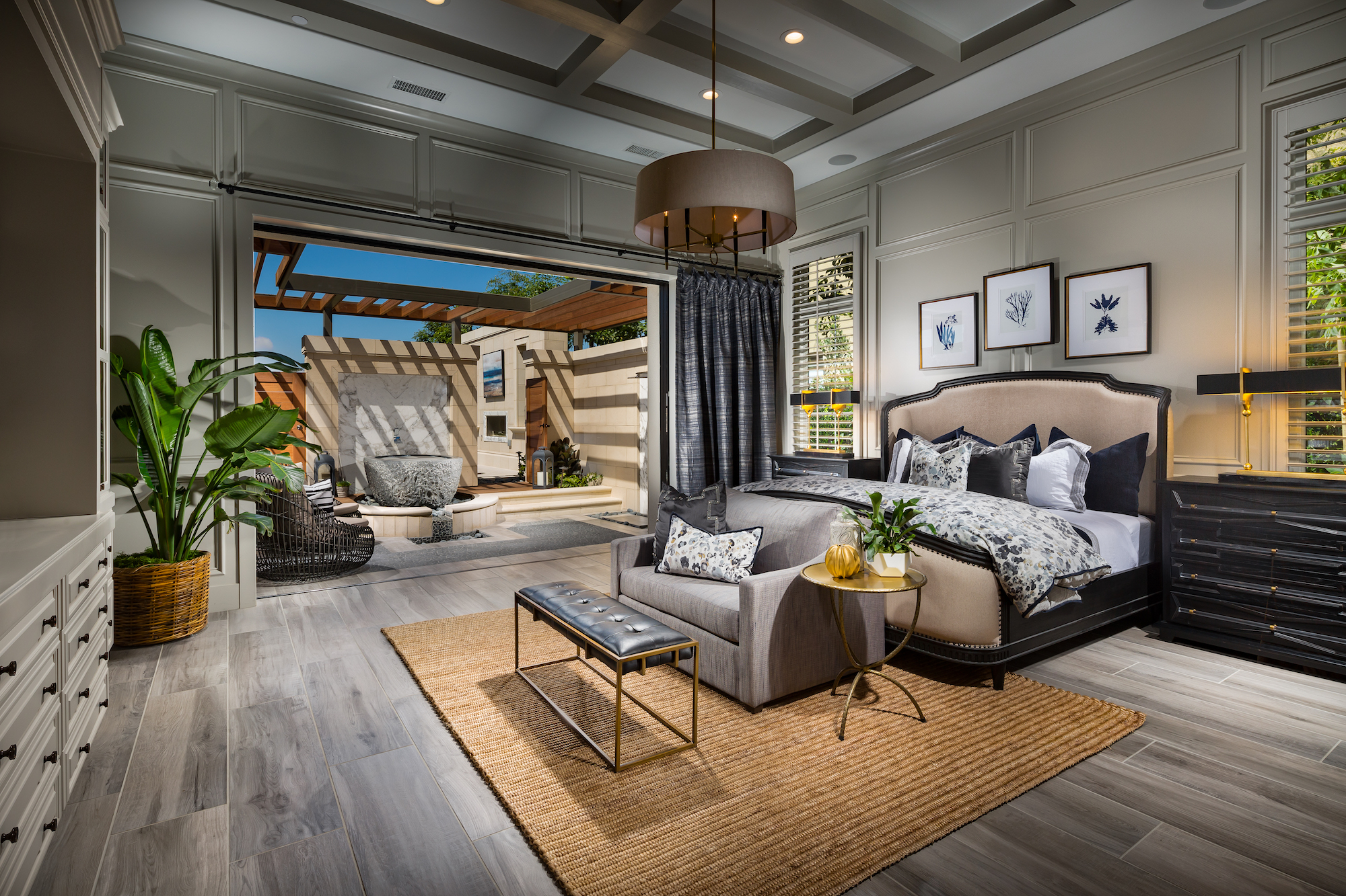 Bedroom in a California home with indoor and outdoor space.