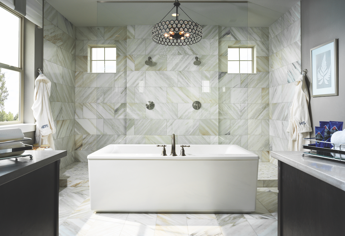 A modern bathroom with mixed metal design elements.