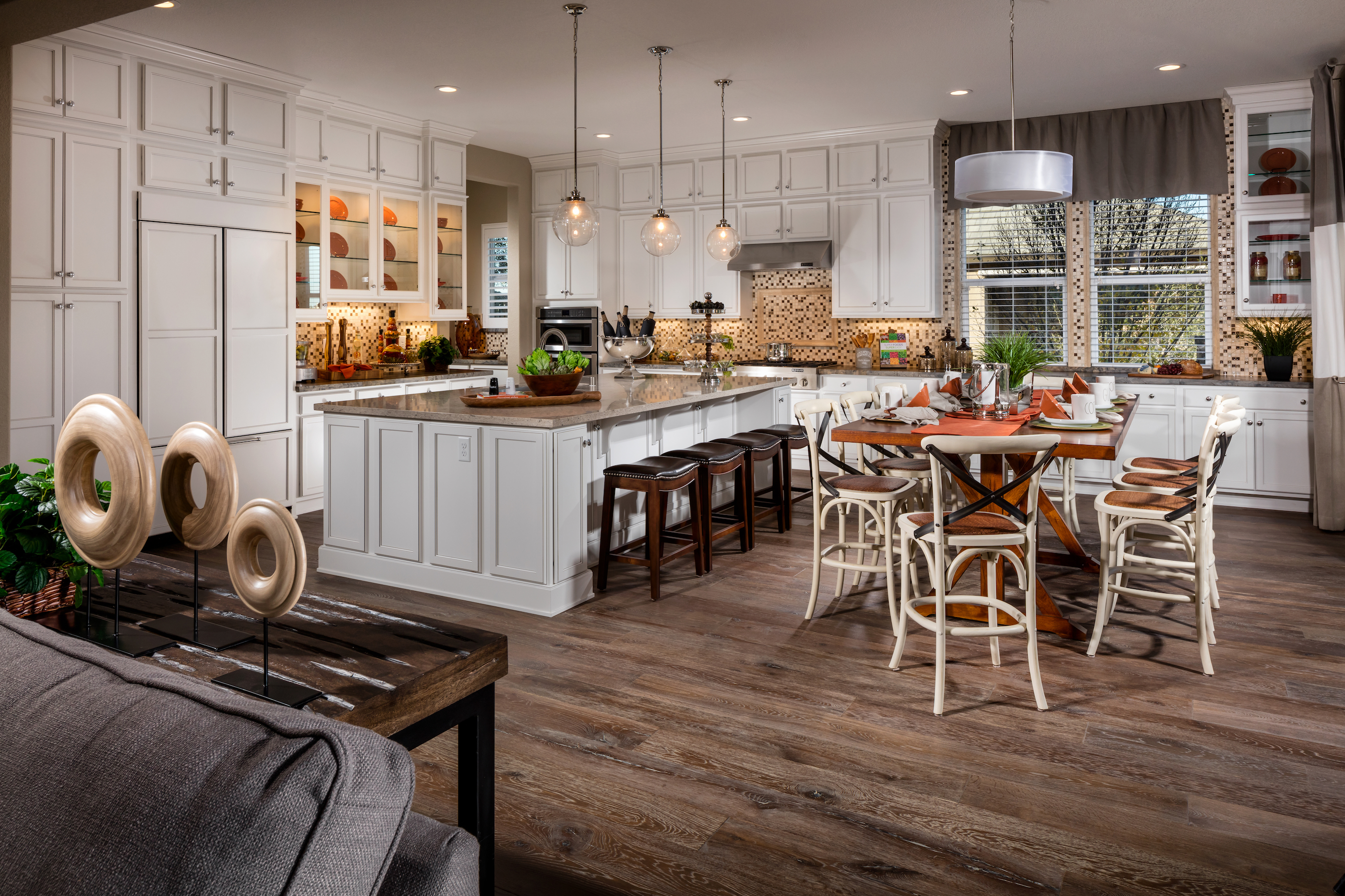 Kitchen with wood floors and white cabinets