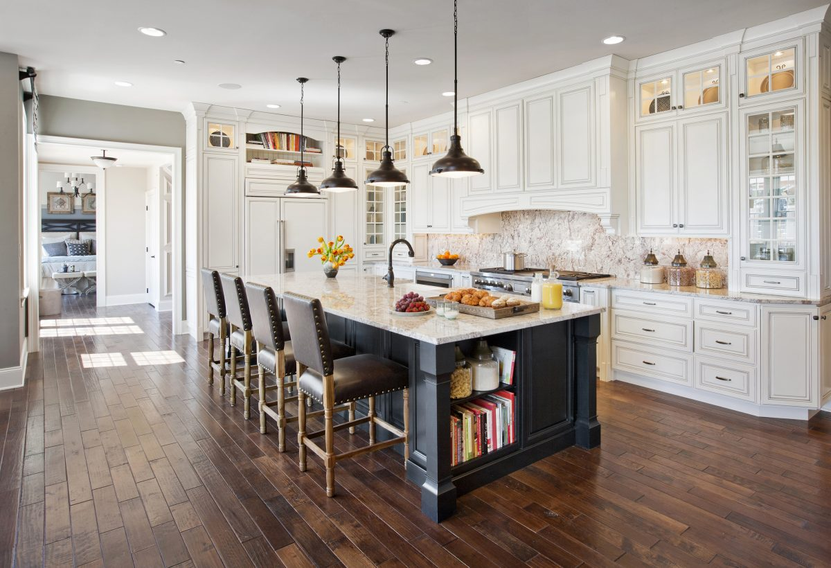 Kitchen with white cabinets and a large island.