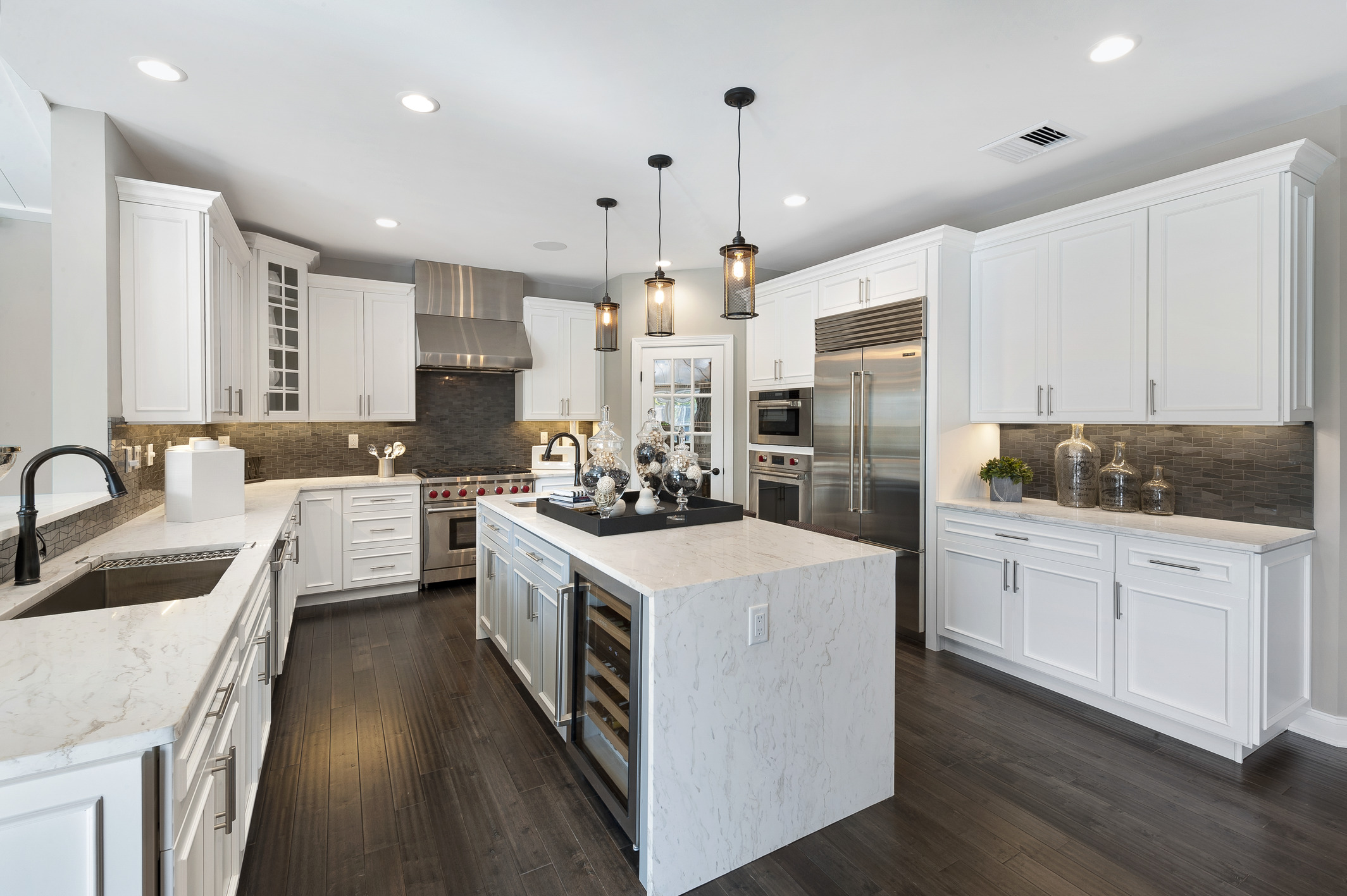 Modern kitchen with pendant fixtures.