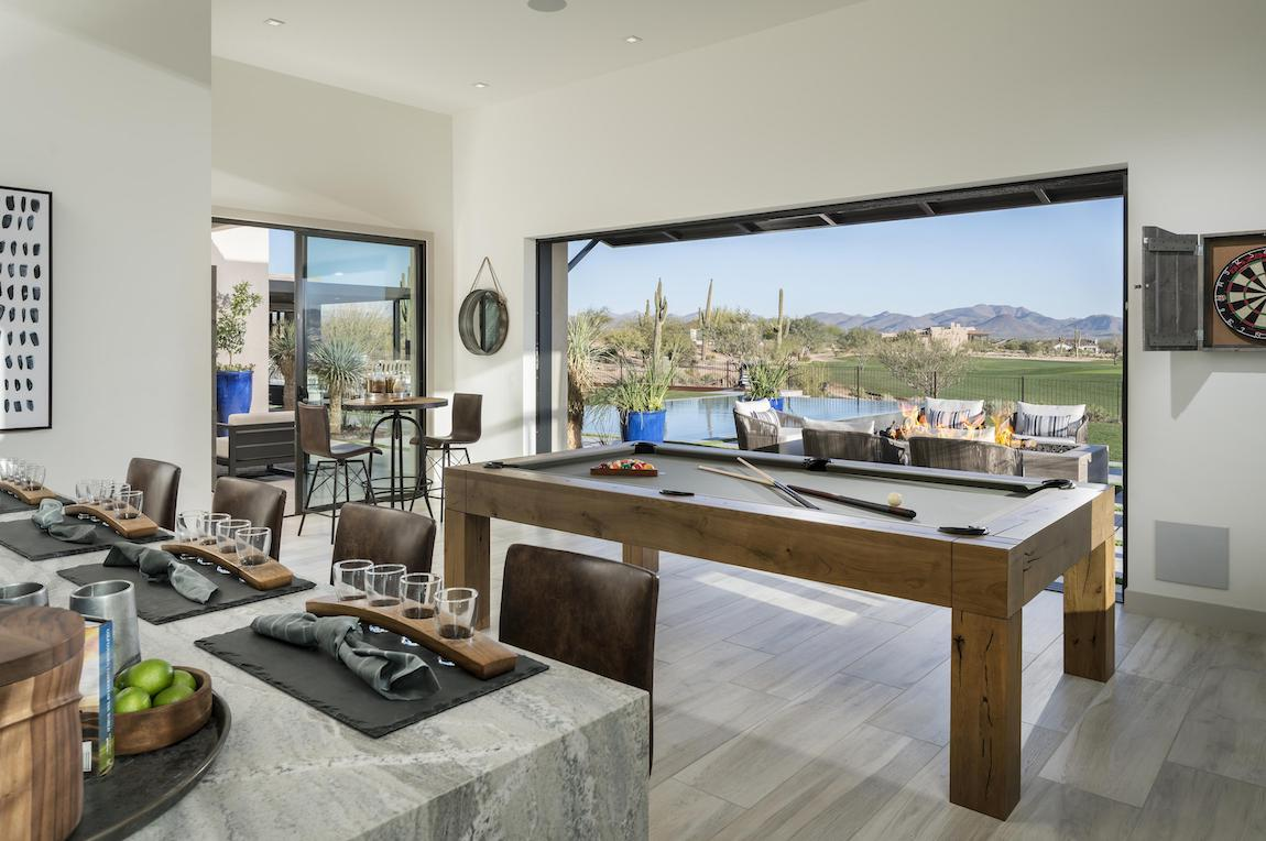 Pool table overlooking a backyard.