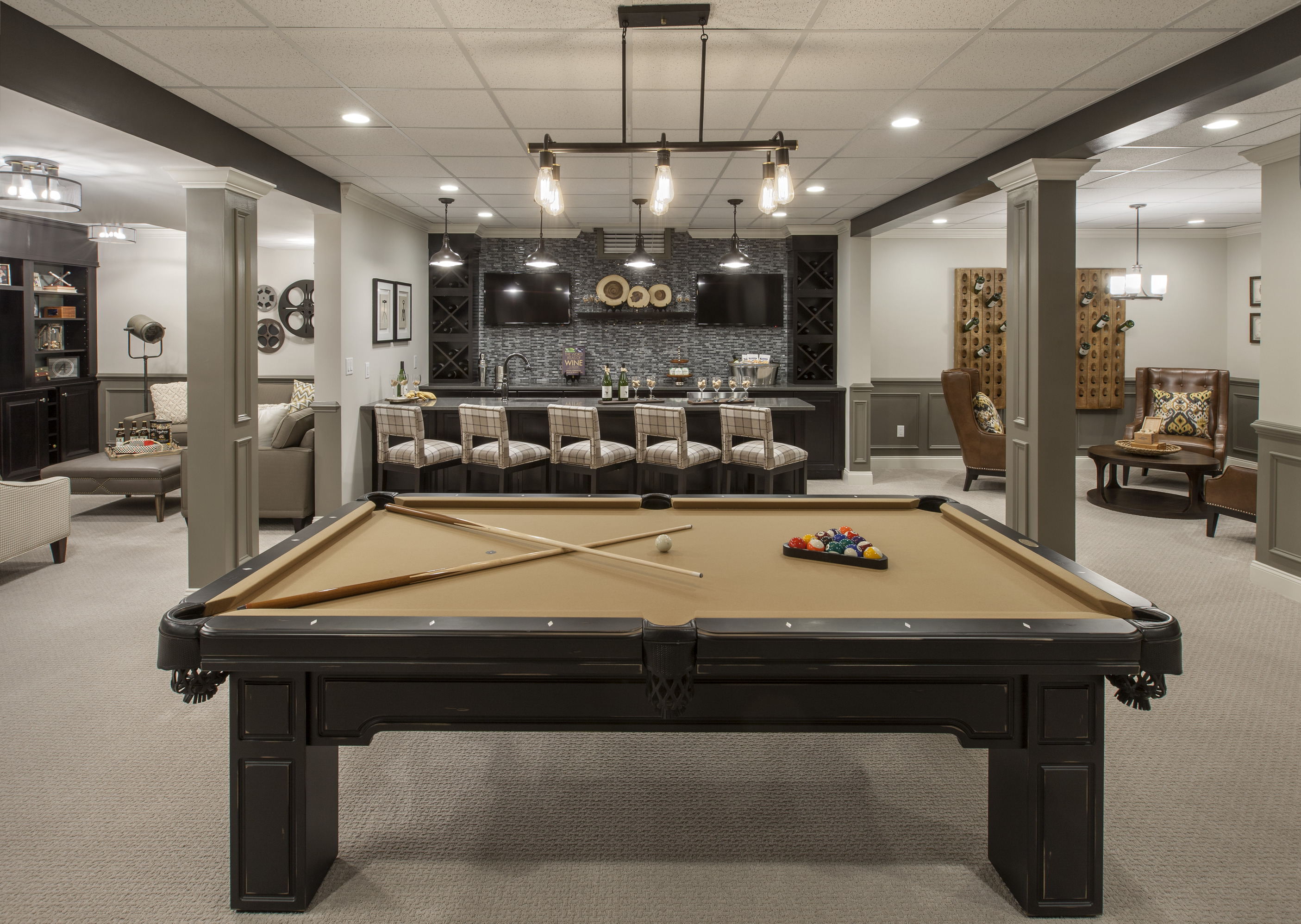 Basement with a bar and a pool table.