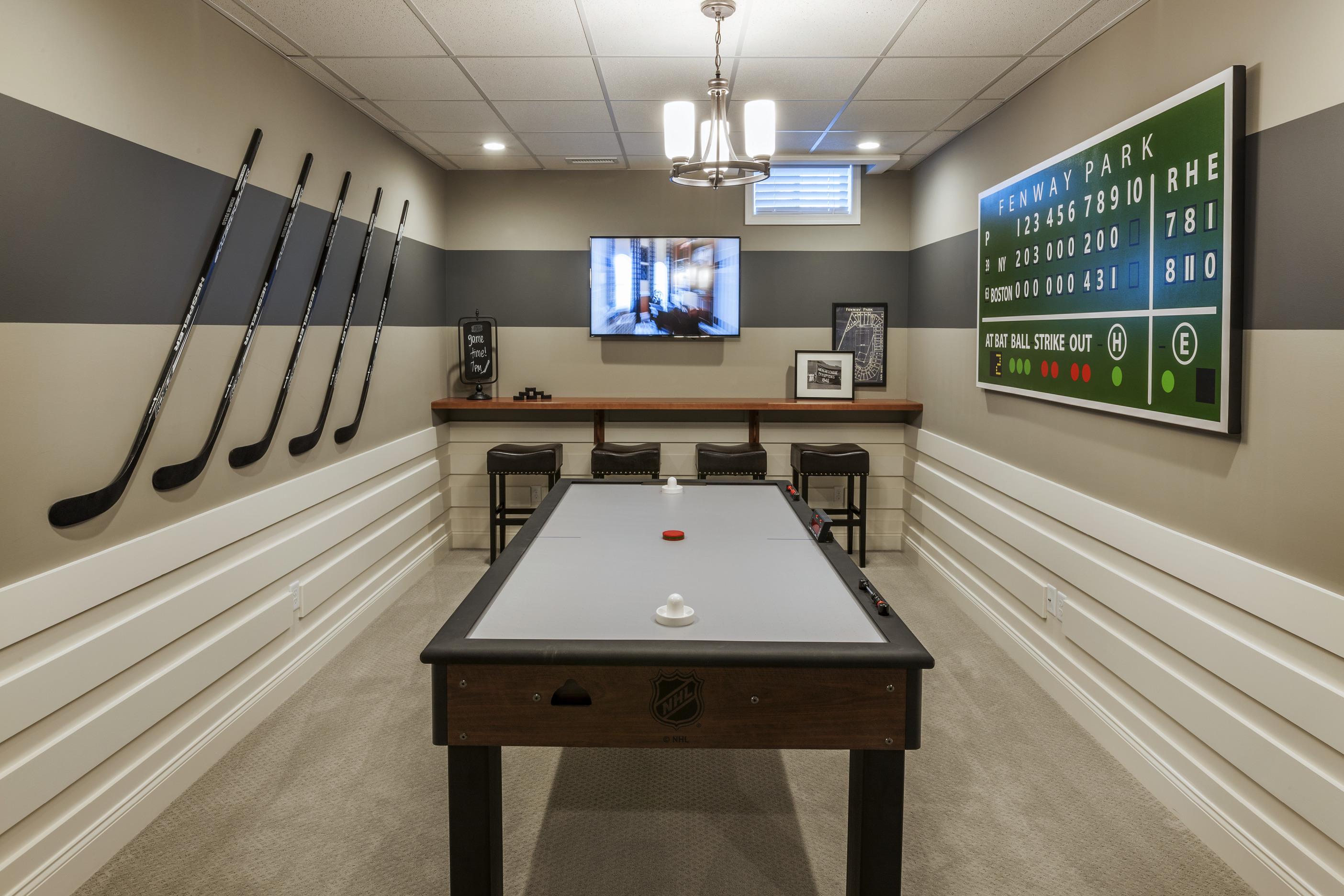 Game room with a pool table and a TV.