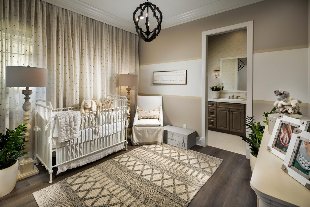 Nursery with painted wall.