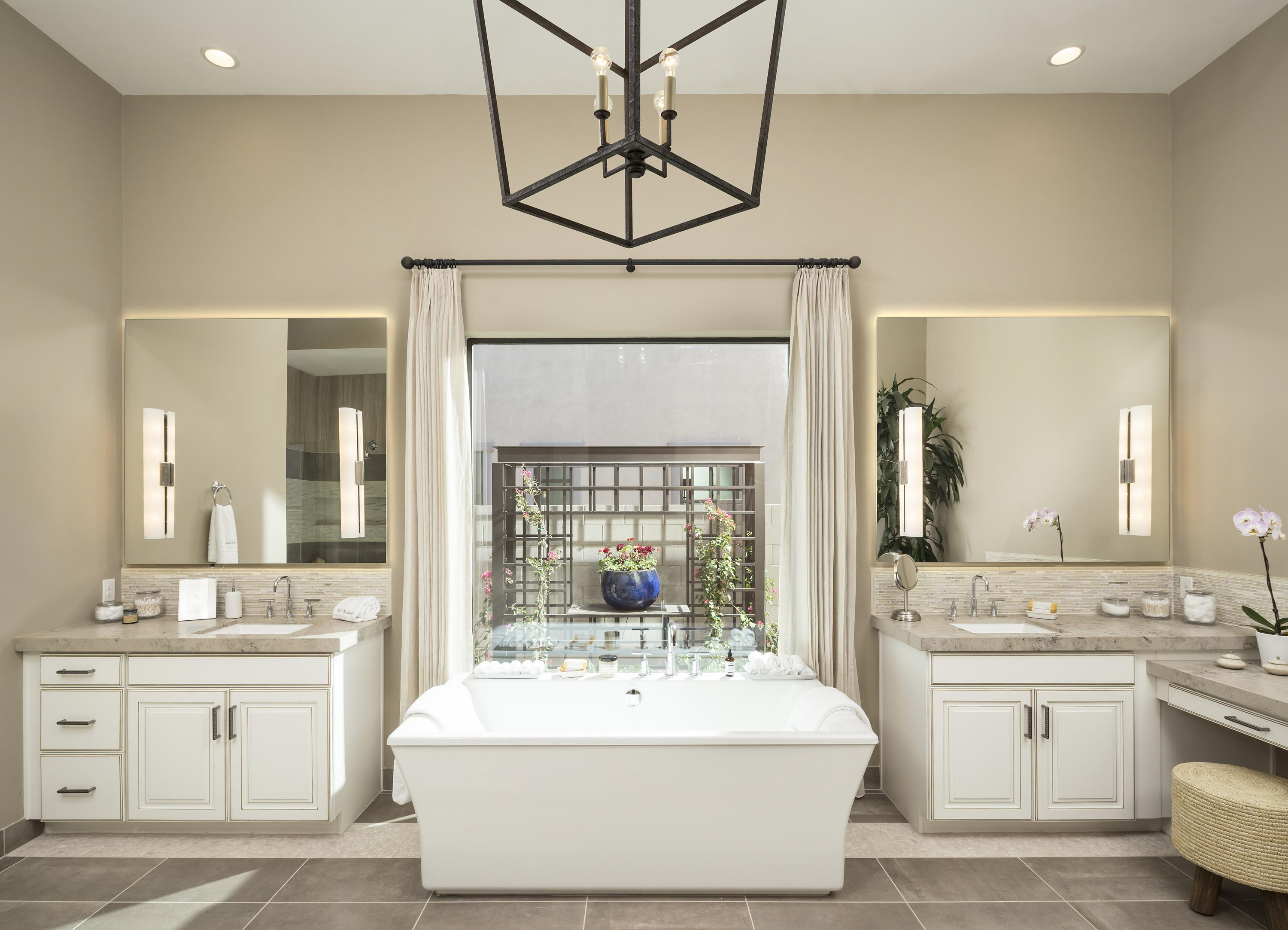 Bathroom with beige colored walls and a free standing bathtub.