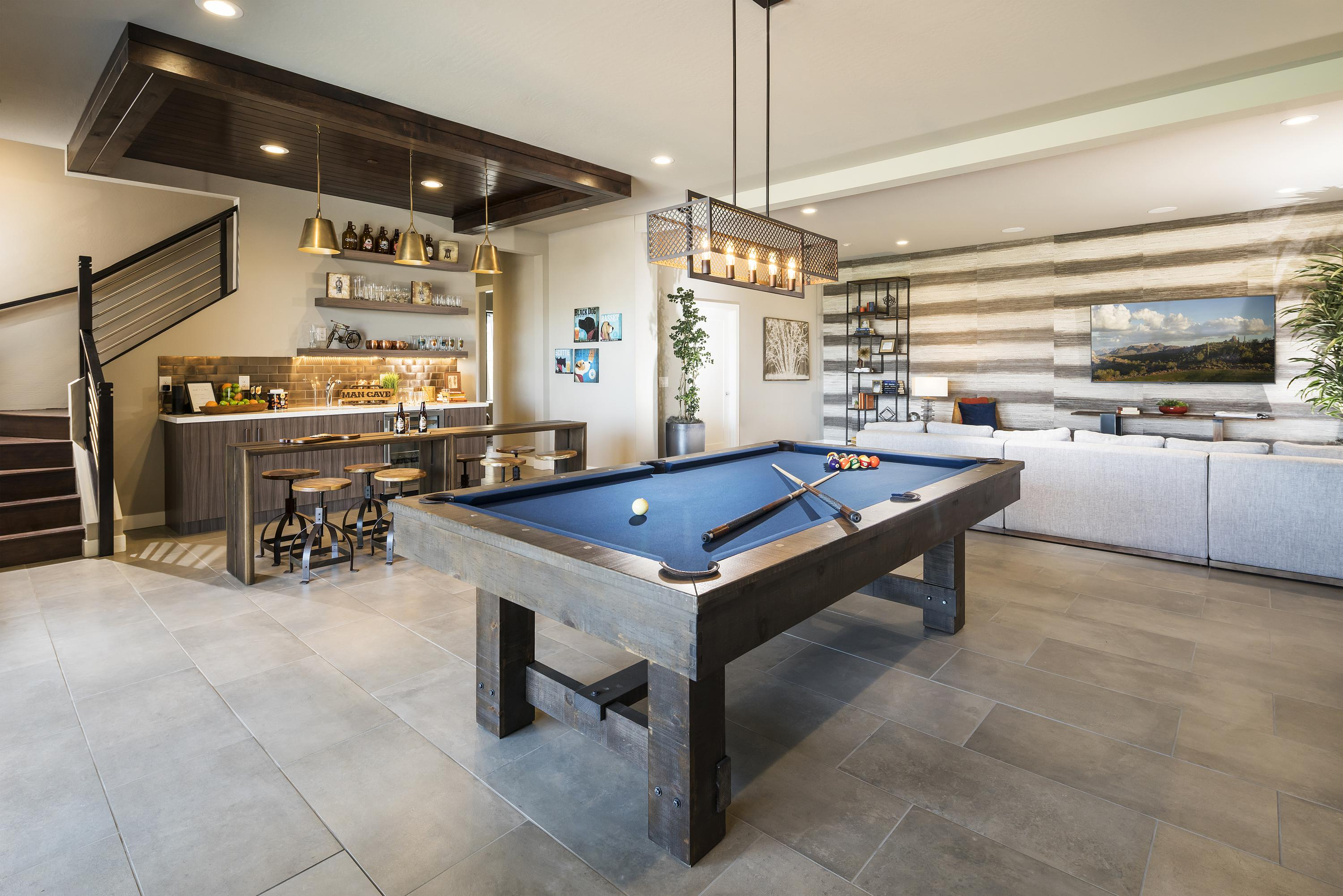 Game room with a bar perfect for hosting parties.