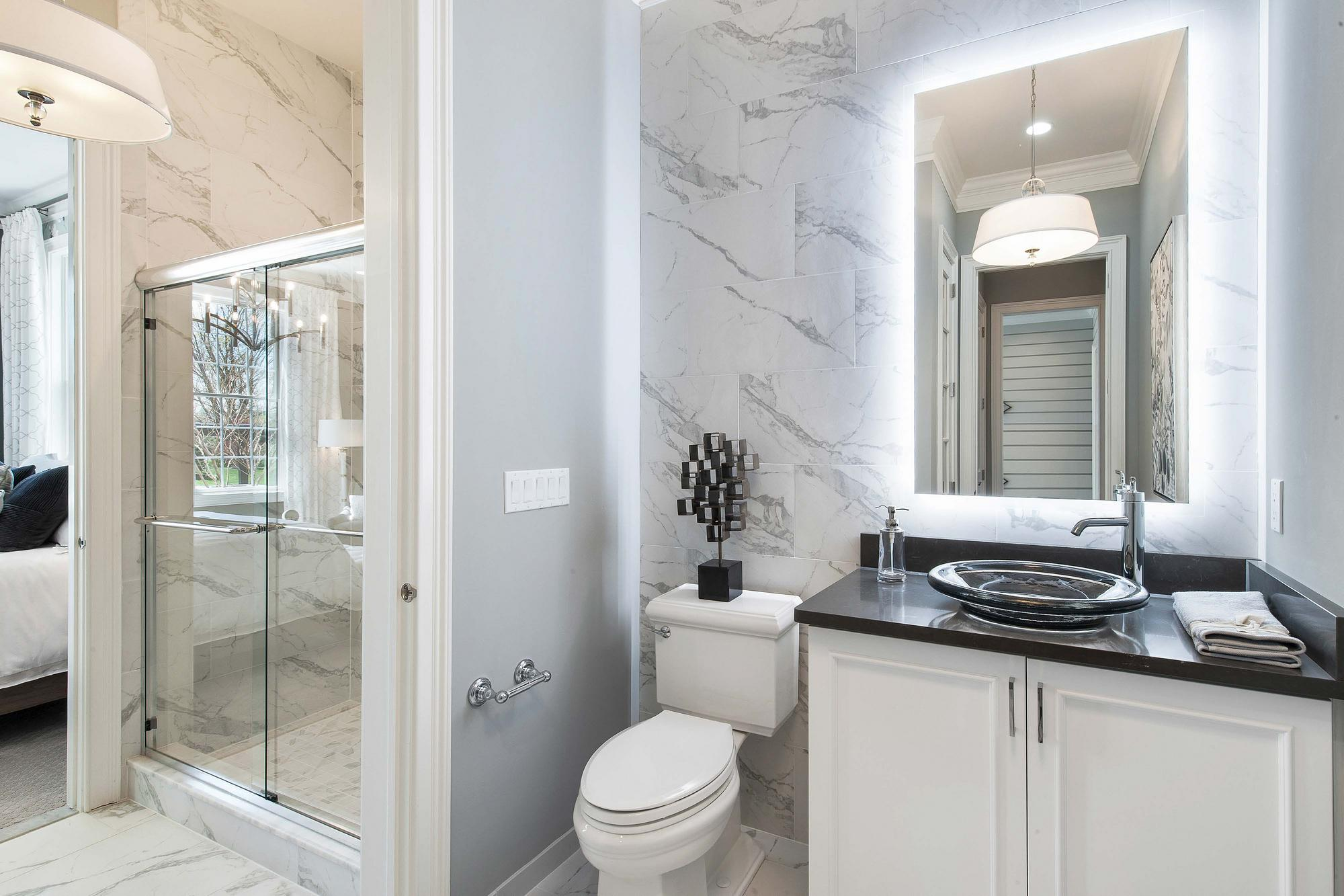 Bathroom with modern lighting and fixtures.
