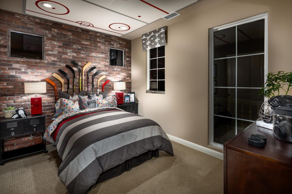 Teen bedroom with hockey theme design.