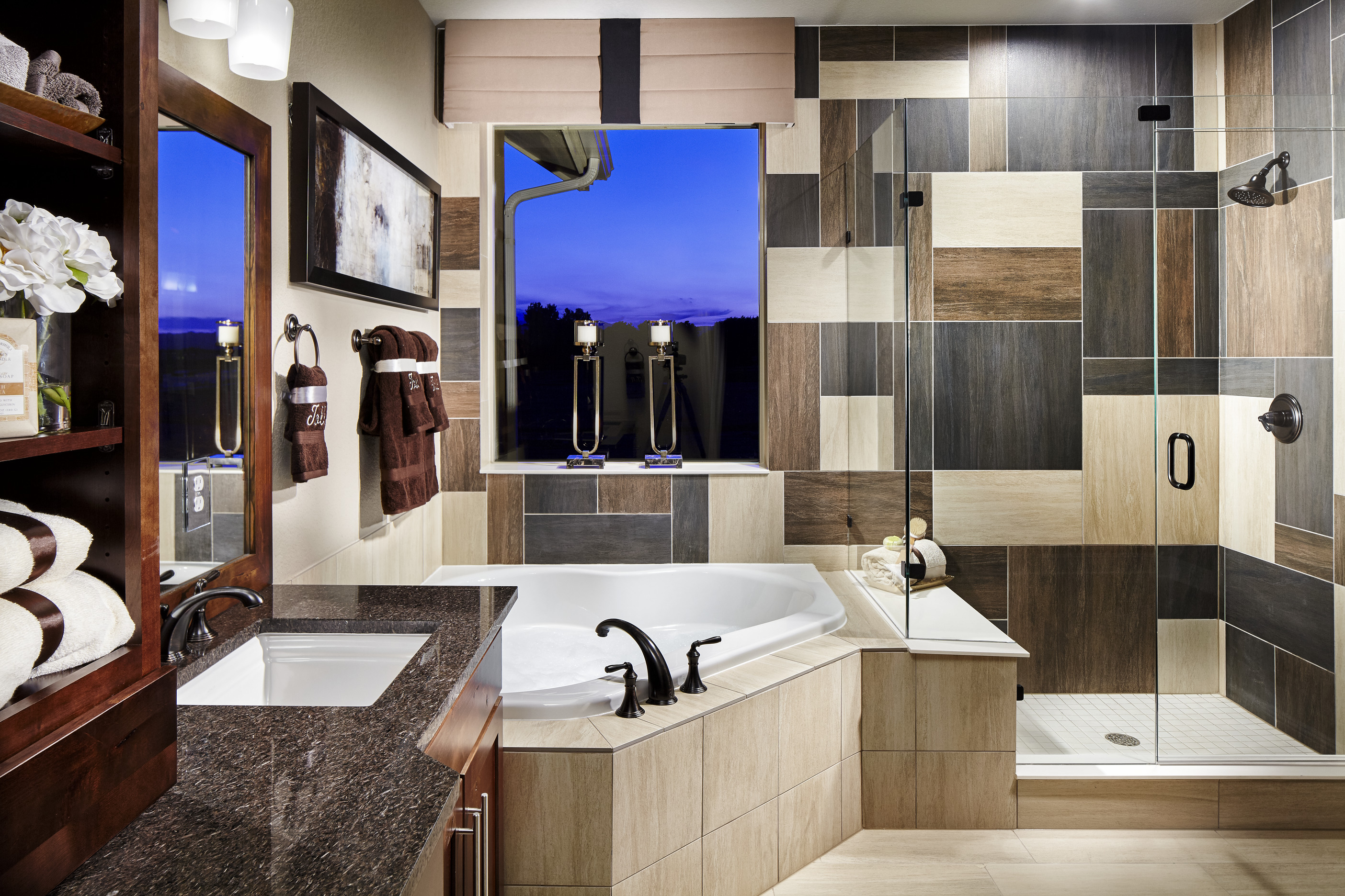Modern bathroom with jacuzzi tub and multi colored tiles.