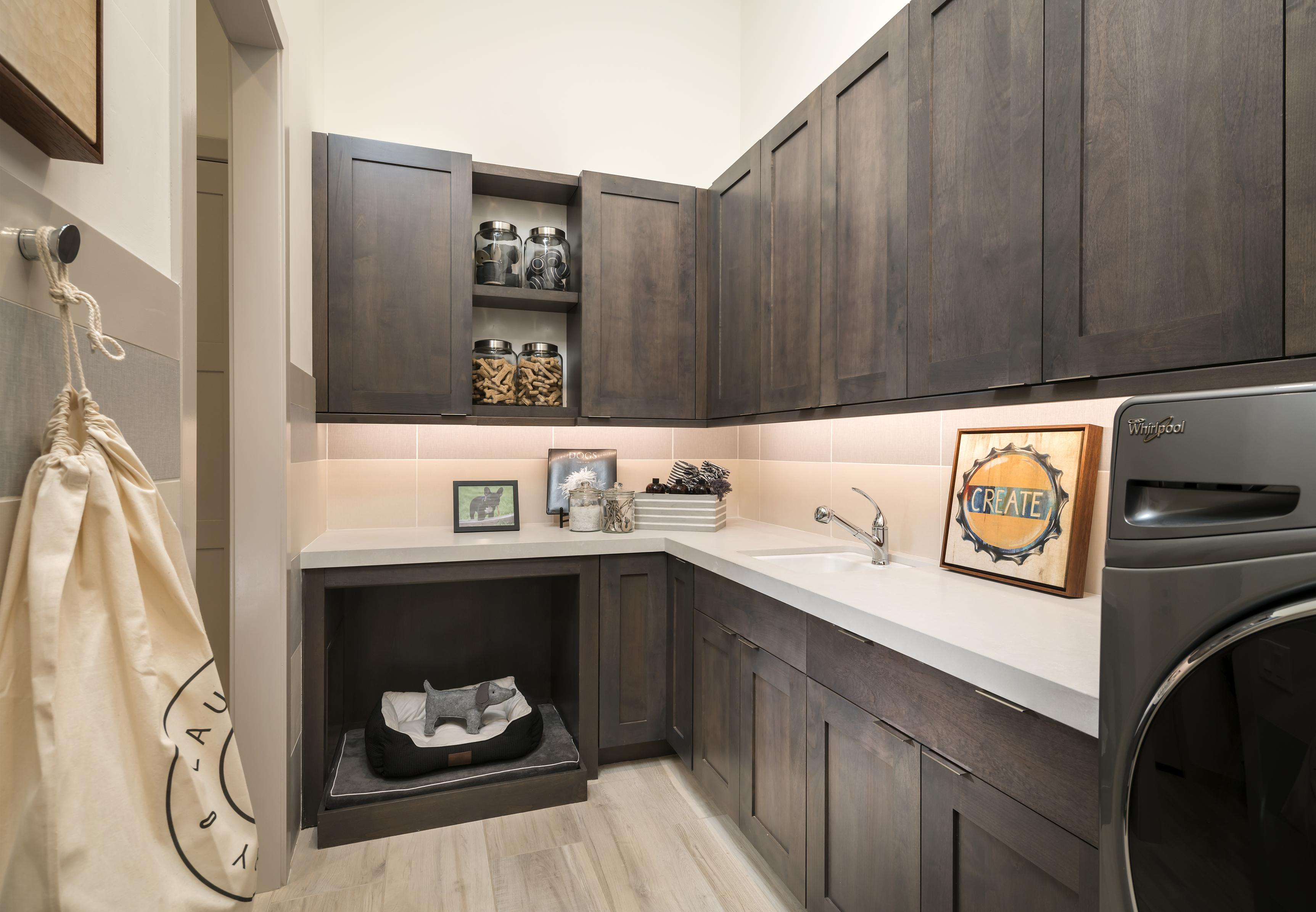 Laundry room with modern design and wooden cabinets.
