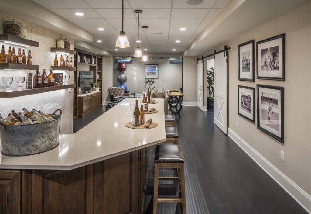 Basement with a home bar.