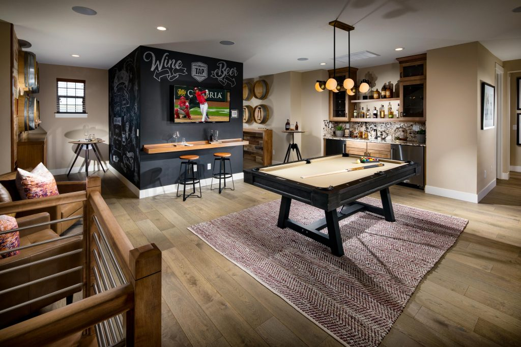 Basement game room with a pool table.