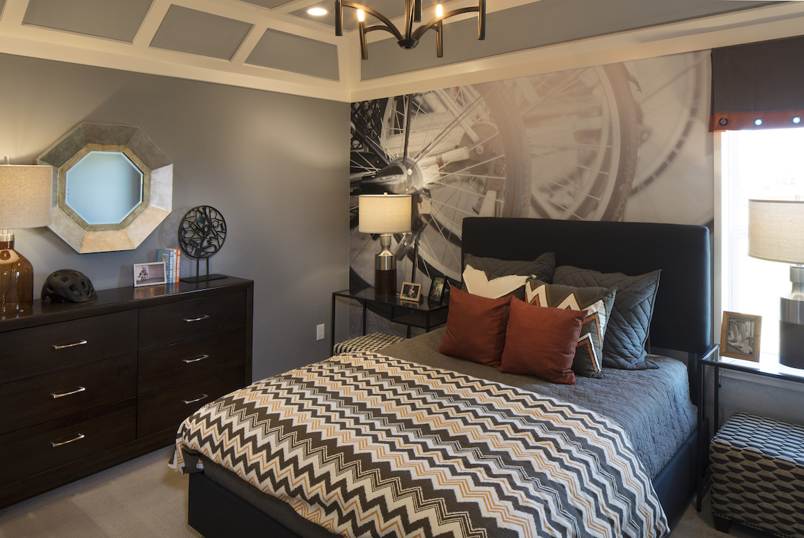 Bedroom with grey colors in the design.