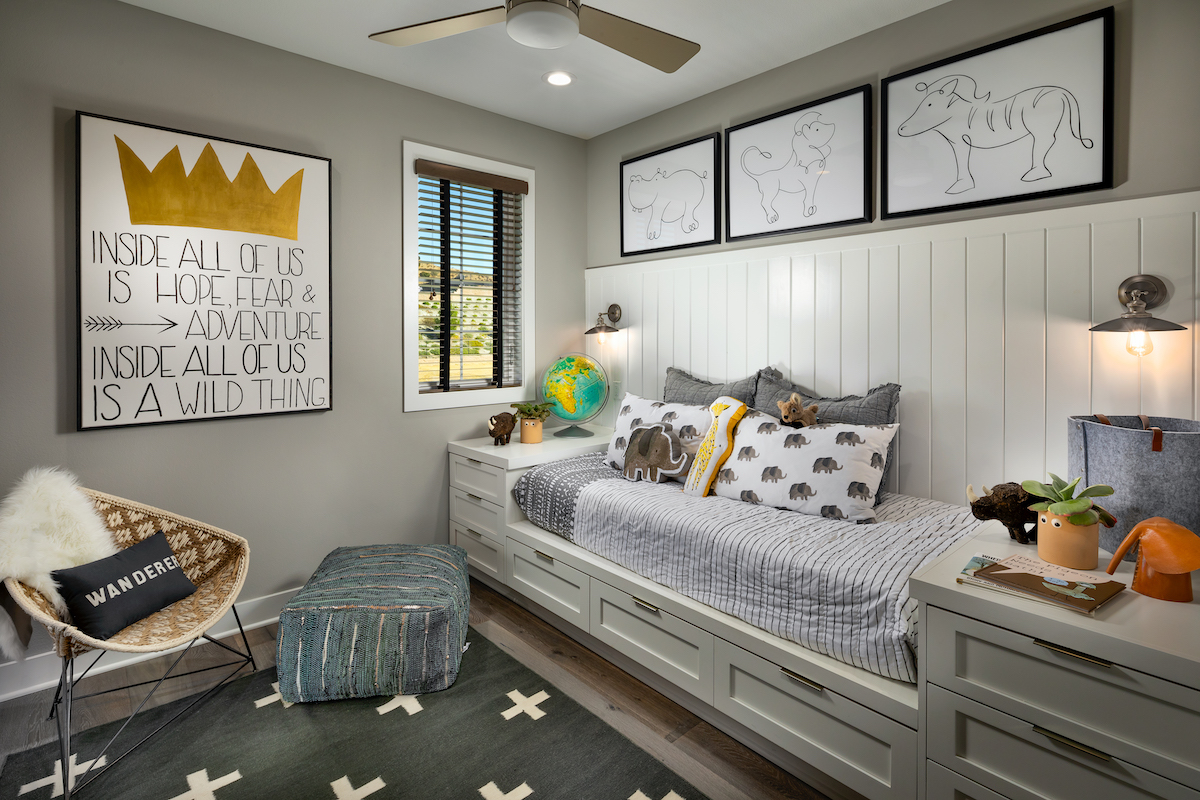 Small bedroom with storage under child's bed.