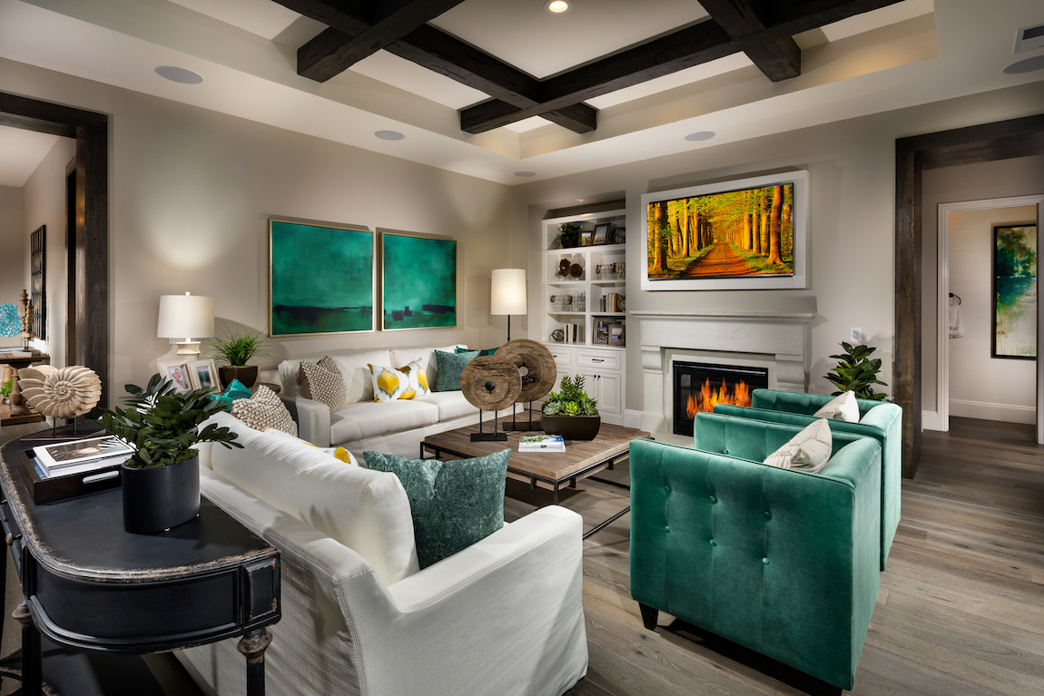 Living room with colorful furniture used to accent the design.