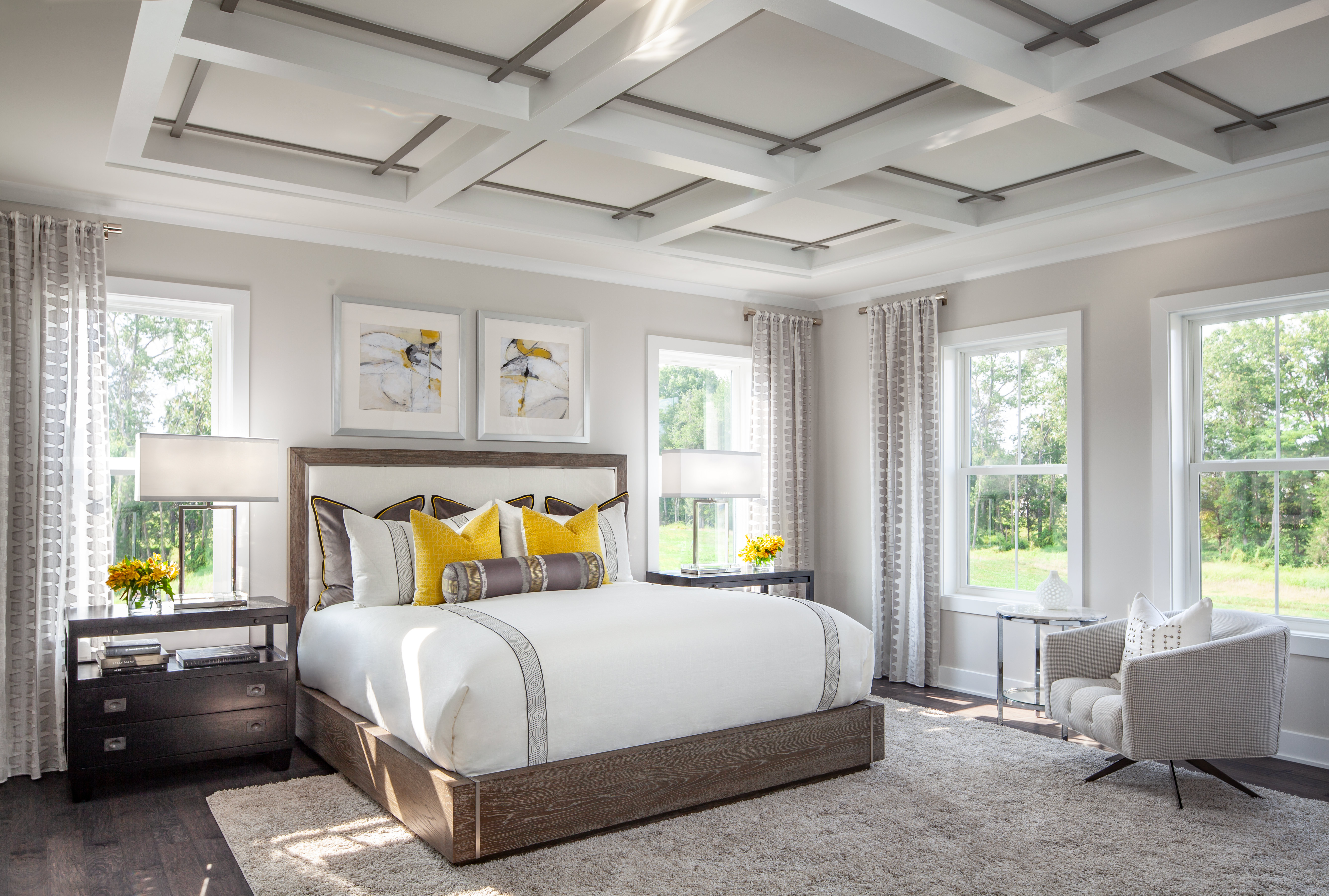 Small bedroom with yellow color accents.