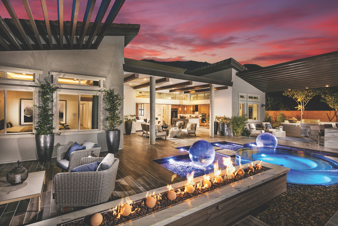 Backyard with a pool and a fire pit.
