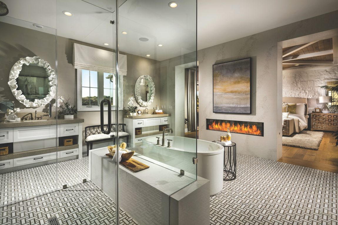 Master bathroom with a fireplace.