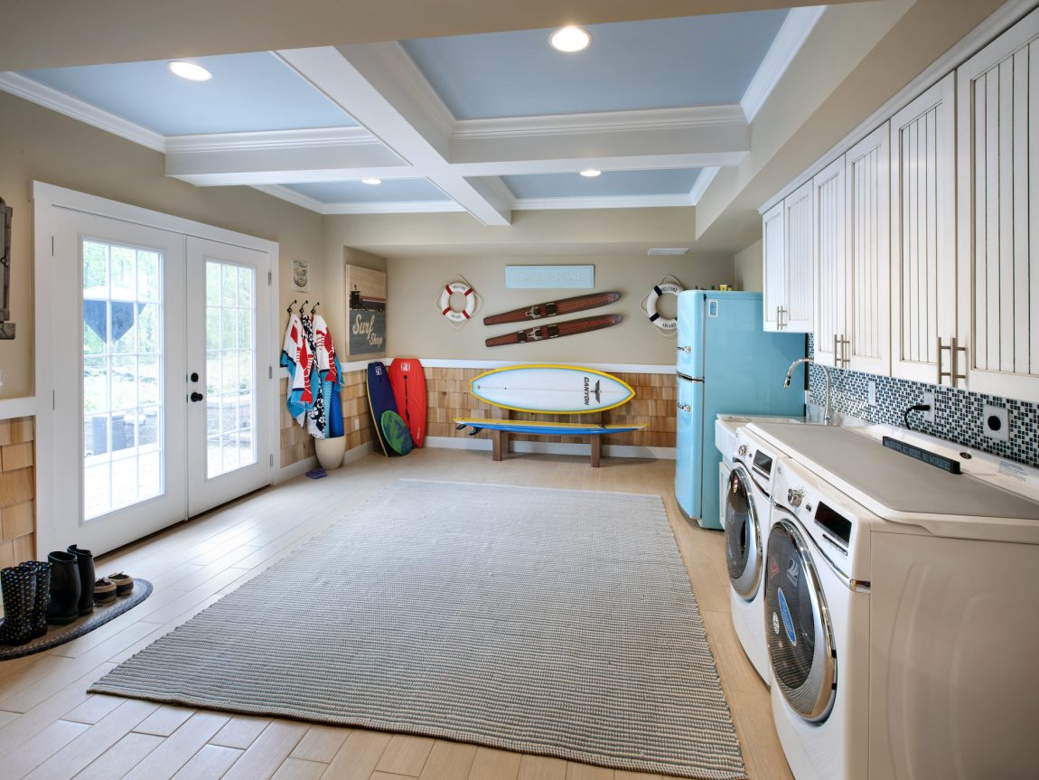 Large mudroom with laundry area and sports equipment.
