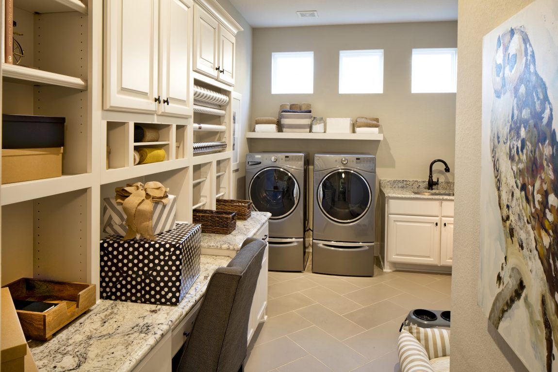 Mudroom with granite countertop and washer and dryer.