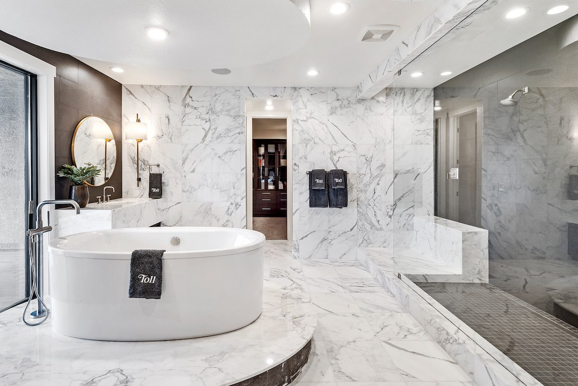 Bathroom with marble and soaking tub.
