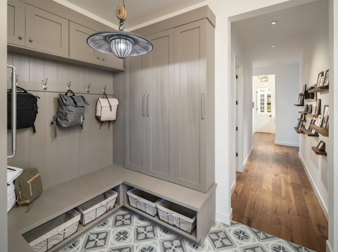 Modern mudroom with bench seating and coat hooks.
