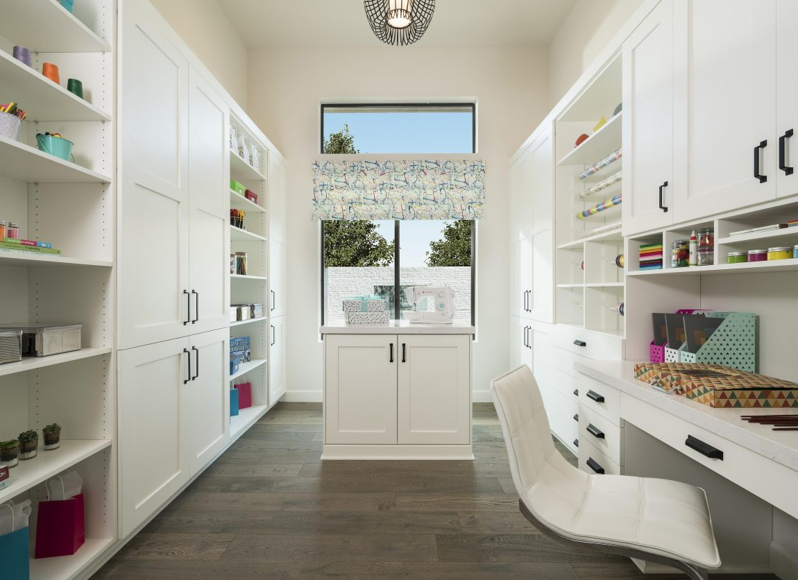 Craft room with white cabinets