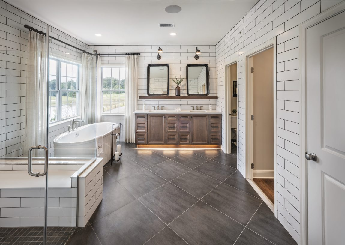 Farmhouse style bathroom with a luxurious bathtub and shower.